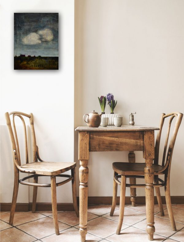 expressionist moody paining of cityscape over small table