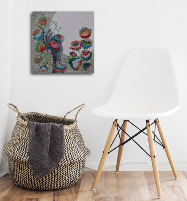 expressionist contemporary paining of hand flowers and moon pinks greens white textured over small chair