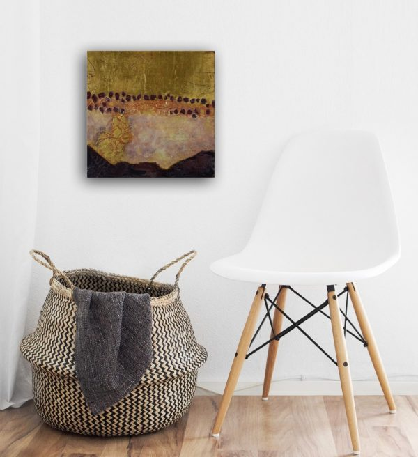 small distressed abstract paining with gold leaf over small chair