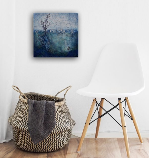 small abstract paining landscape in blue over small chair