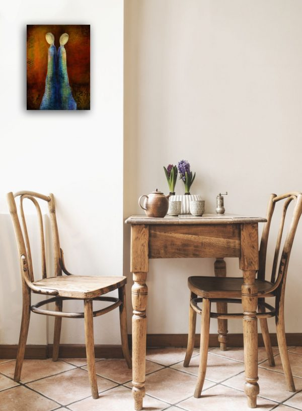 small painting over table of twin figures back to back